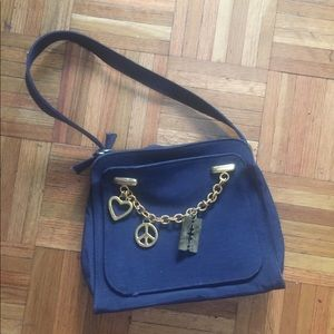 Vintage Moschino designer purse as is condition.